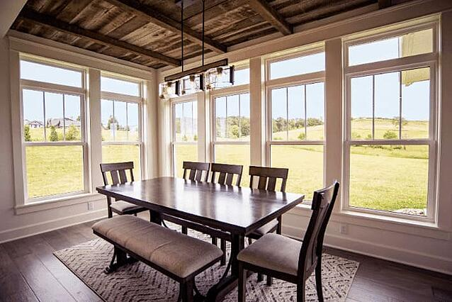 dining room with full window surround